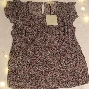 Flutter short sleeve top in a ditsy floral print.